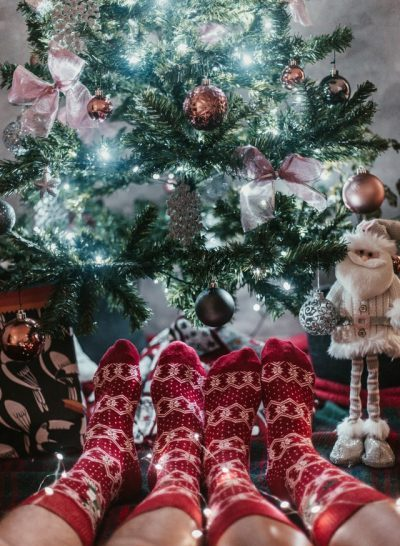 Two Pairs Of Christmas Socks by the Tree