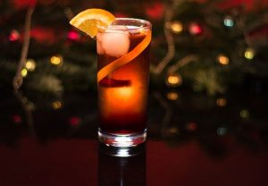 Christmas Cocktail In Front of Twinkly Lights