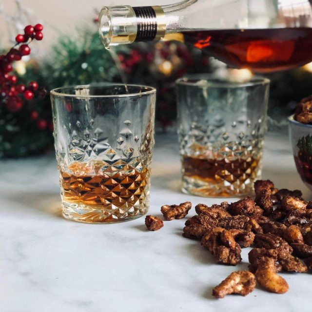 Christmas Spiced Nuts with whisky pouring