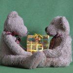 Teddies Sharing a Gift