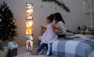 Mother & Daughter looking at photos on a digital display