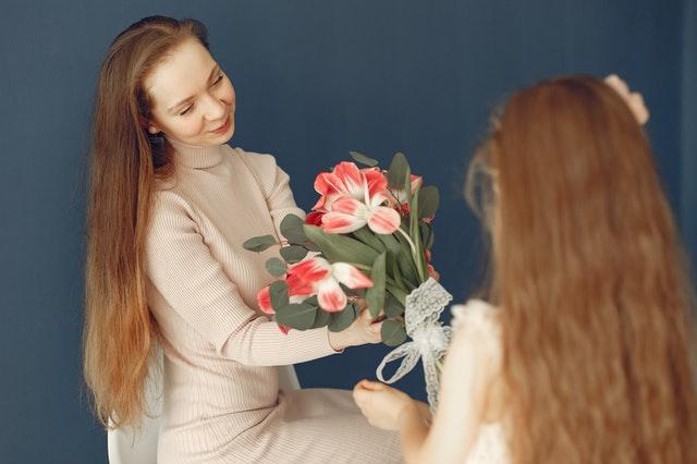 Child giving teacher flowers