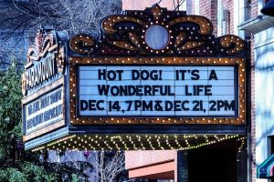 Classic Movie Theatre Entrance Sign At Christmas