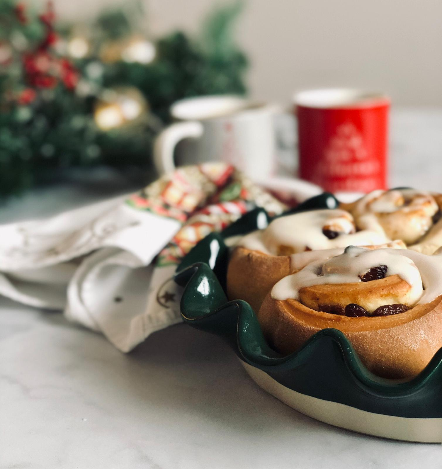 Mince Pie Cinnamon Rolls with coffee cups