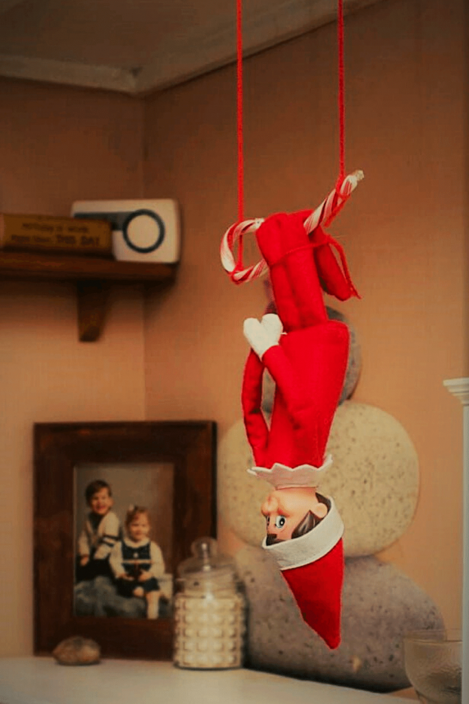 Elf on the Shelf Swinging on a Candy Cane