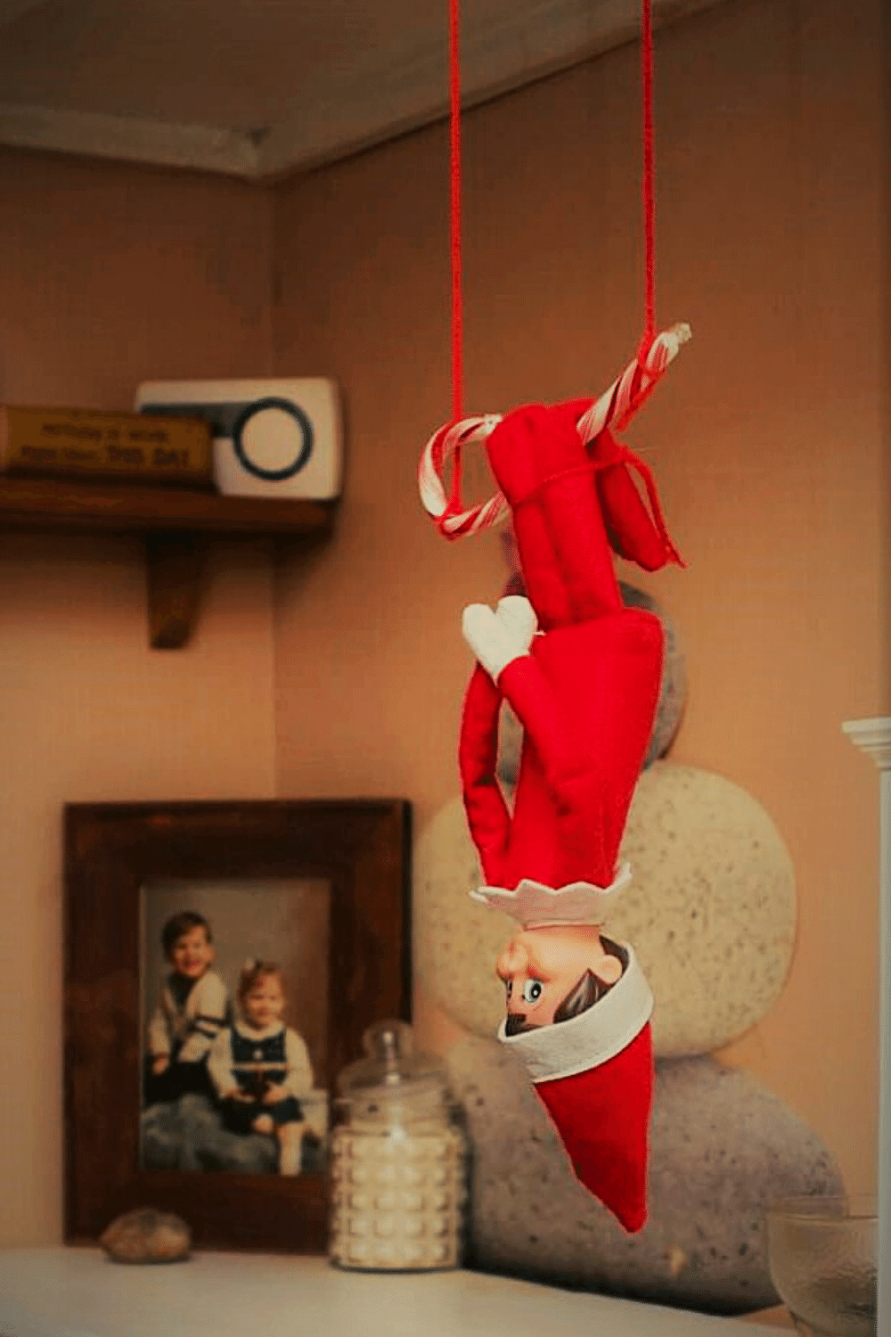 Elf on the Shelf Swinging Upside Down on a Candy Cane