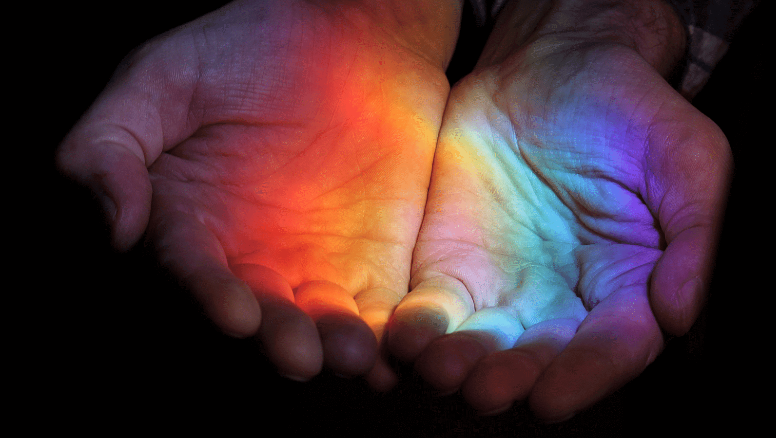 Kindness Advent Calendar: Hands Held with Rainbow Reflecting on Palms