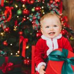 Baby at Christmas Time with Gift