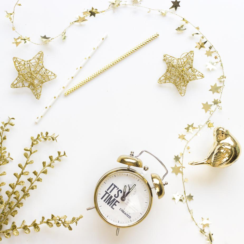 Alarm Clock And Gold Christmas Decorations
