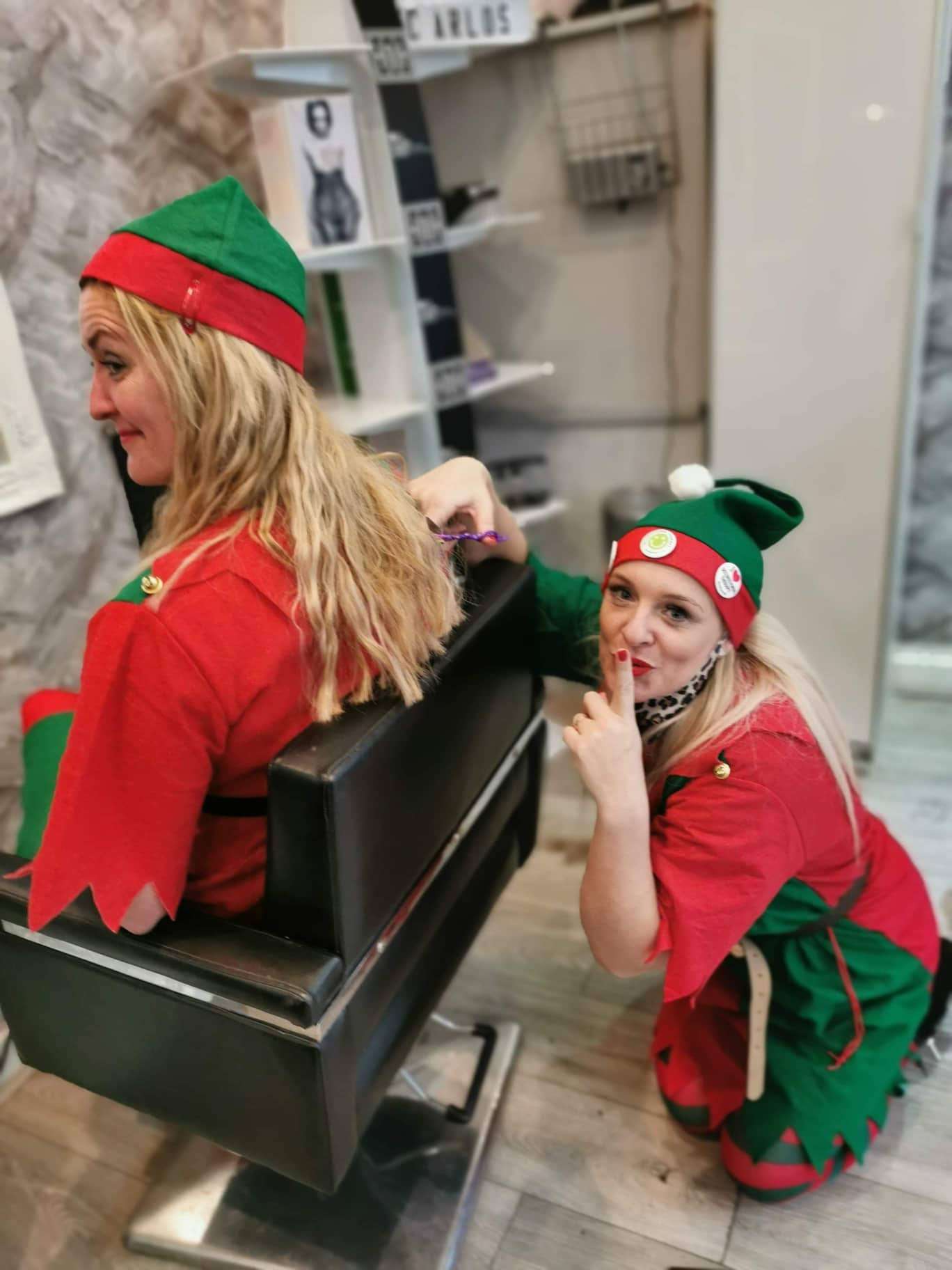 Two women dressed as elves in the hair salon