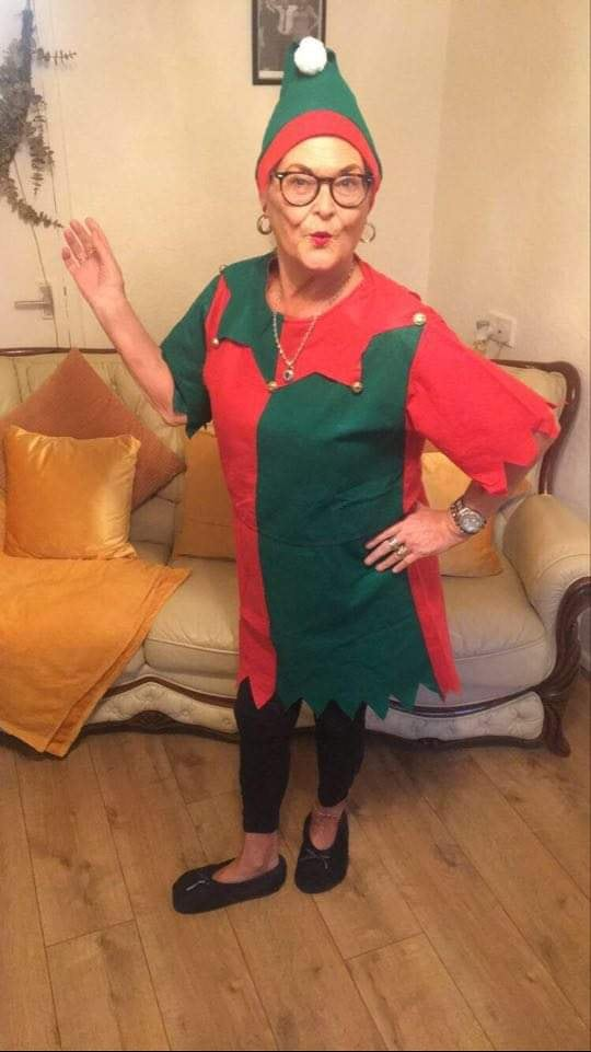 Teeside Elf Joins in from home - lady dressed in elf costume