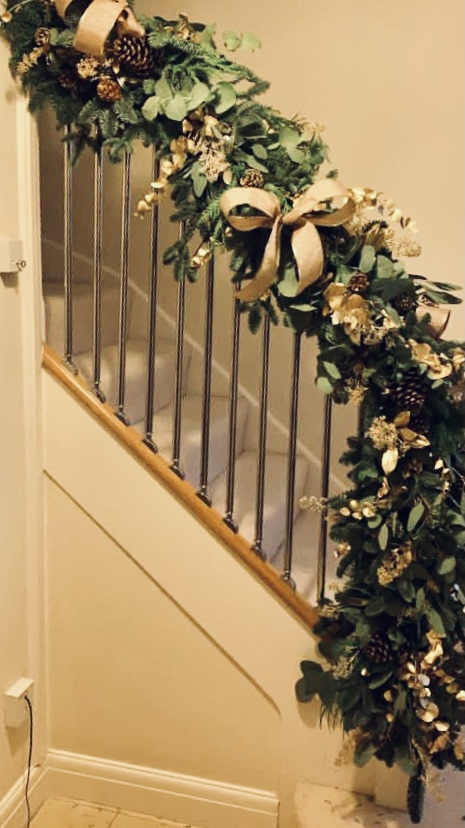 Staircase Garland of Greenery & Gold coming down banister