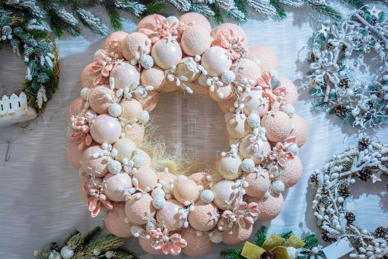 Wreath made of pastel peach coloured baubles