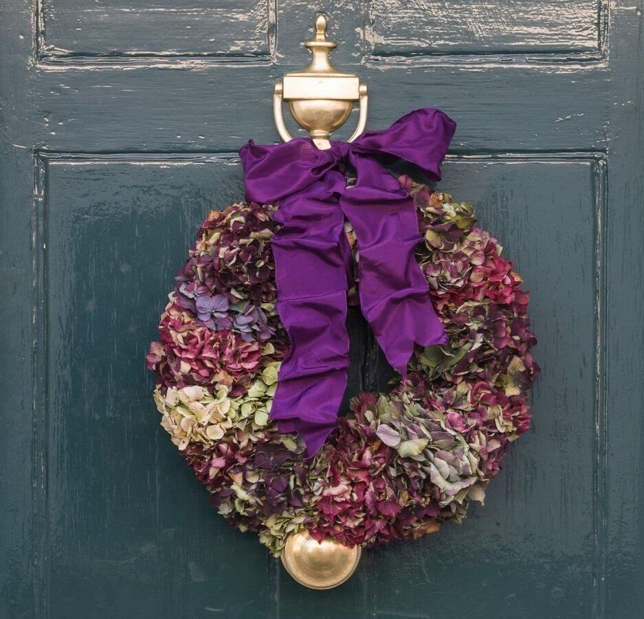 Wreath made from dried Hydrangeas on a teal door