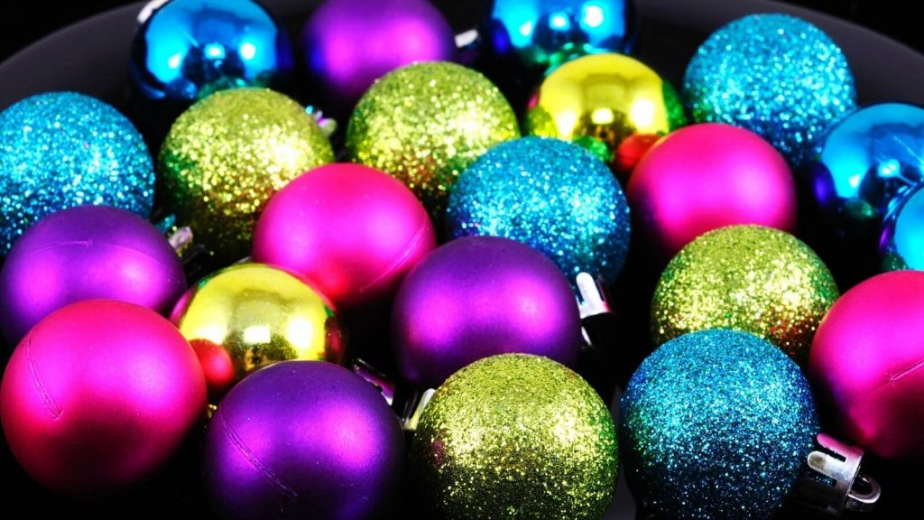 Selection of brightly coloured baubles in a bowl