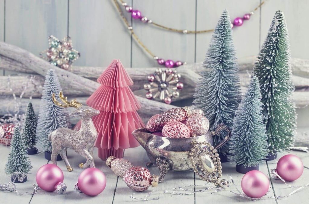 Selection of pastel colours Christmas decorations including mini trees and reindeer