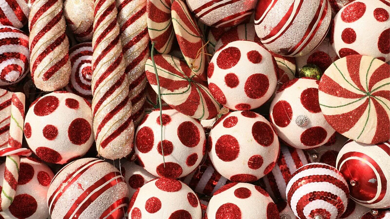 Lots of candy cane patterned baubles