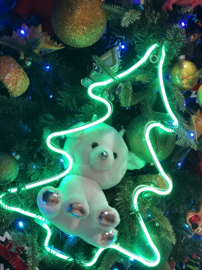 LED Christmas Tree Light on a Christmas Tree with Soft Teddy tucked in behind