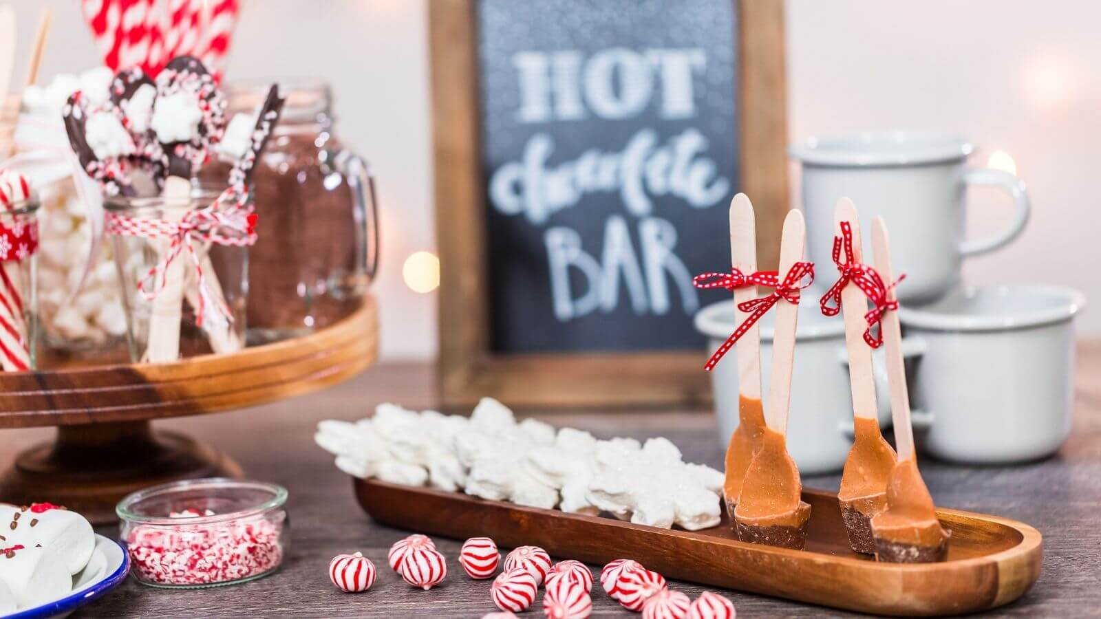Hot Chocolate Station with selection of sweets, toppings, mugs and hot chocolate dipping sticks