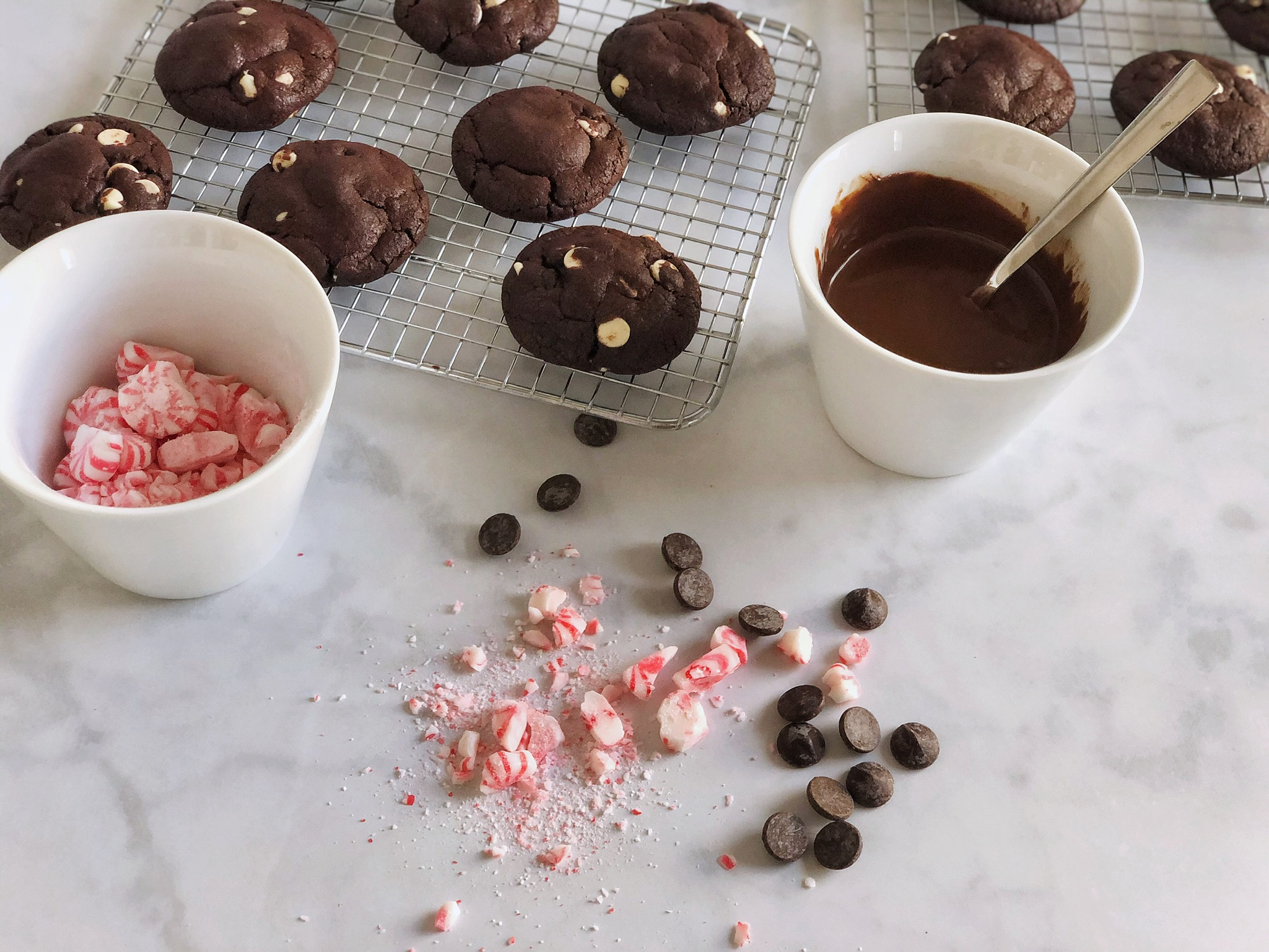 Cookies with crumbled candy cane and dipping chocolate