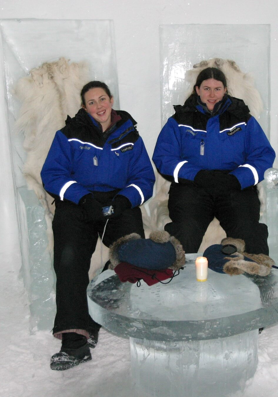 Hannah & Jo in snow suits on ice chairs at the Ice Hotel