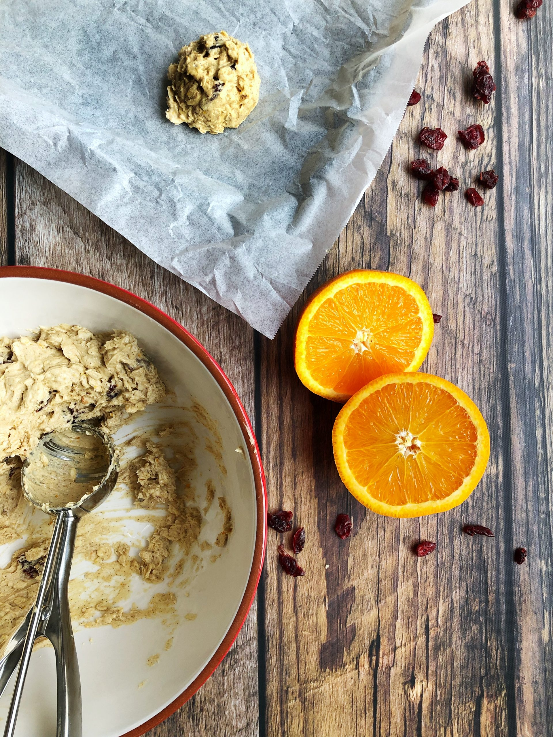 Scooping Oatmeal Cookies with Orange & Cranberries