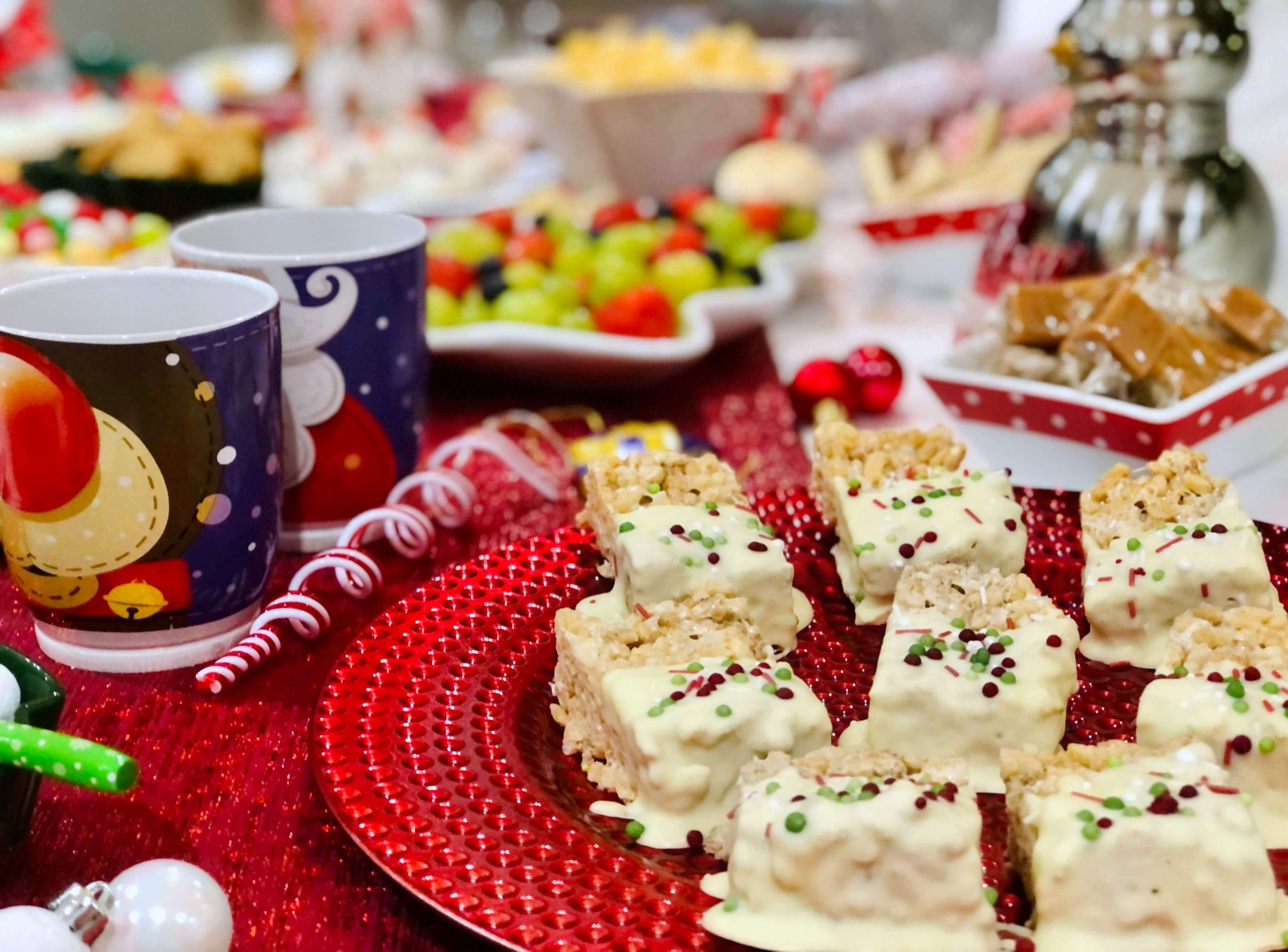 Side view of a North Pole Breakfast table with brown butter Krispie cakes in front of shot