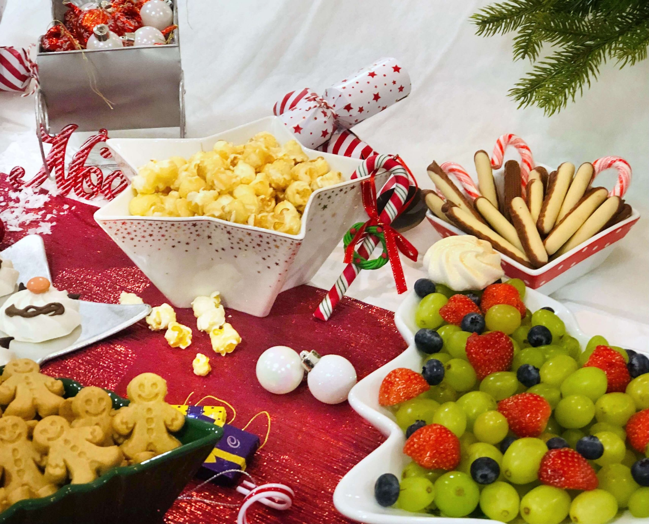 North Pole Breakfast goodies including popcorn & fruit in festive dishes