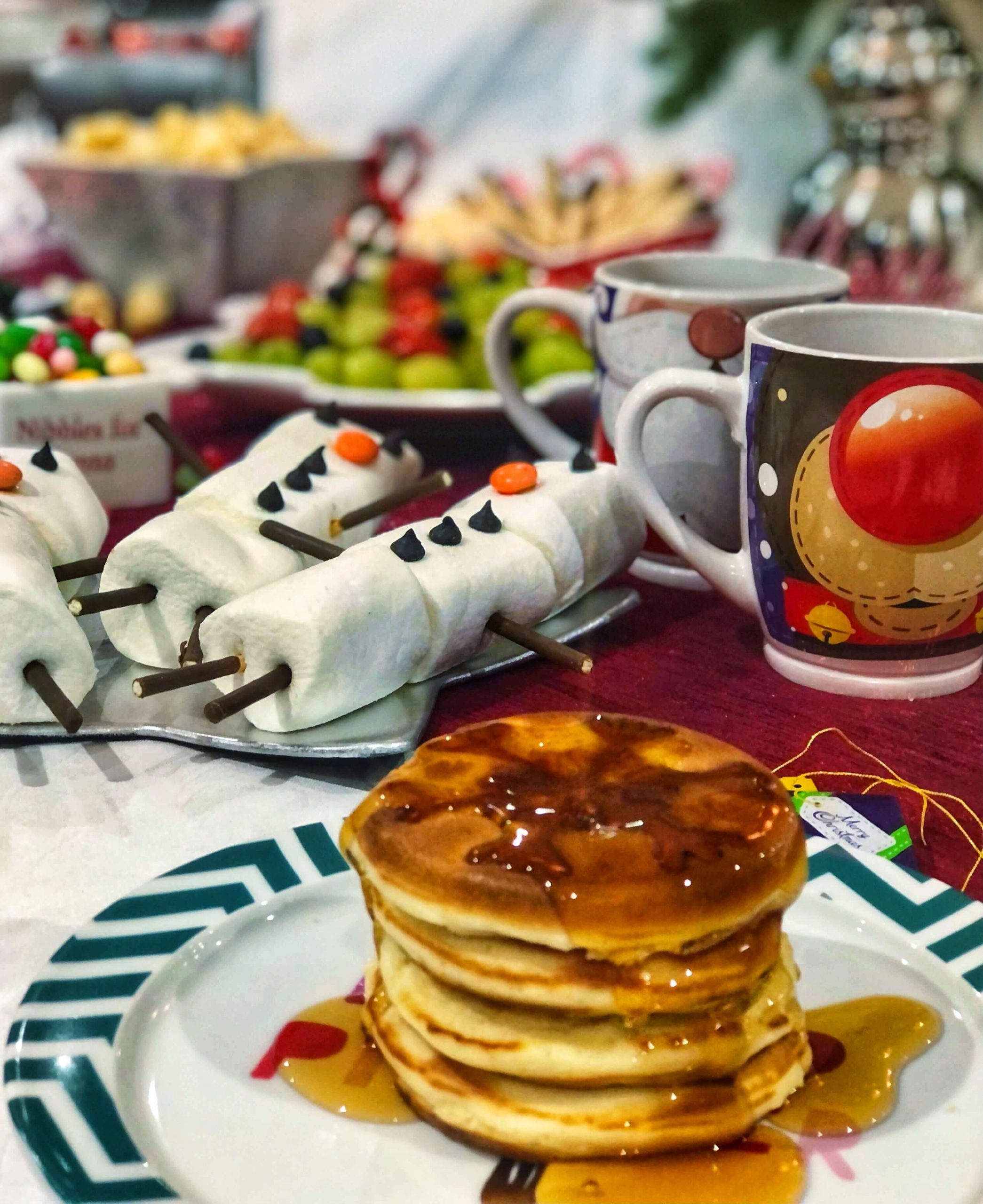 Stack of Christmas pancakes on table of North Pole Breakfast goodies