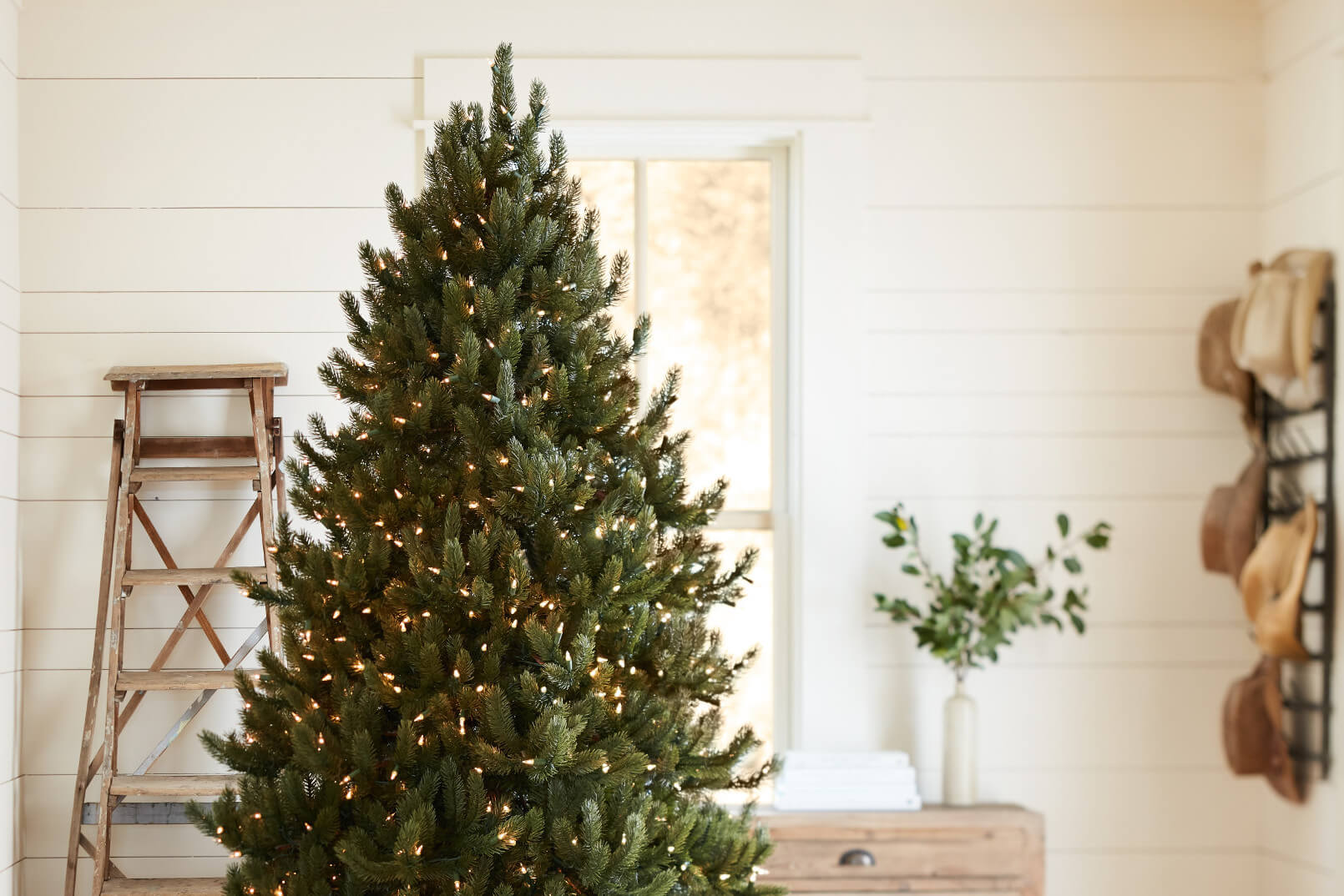 Balsam Hill Vermont White Spruce Artificial Christmas Tree - Prelit Christmas Tree in front of simple background