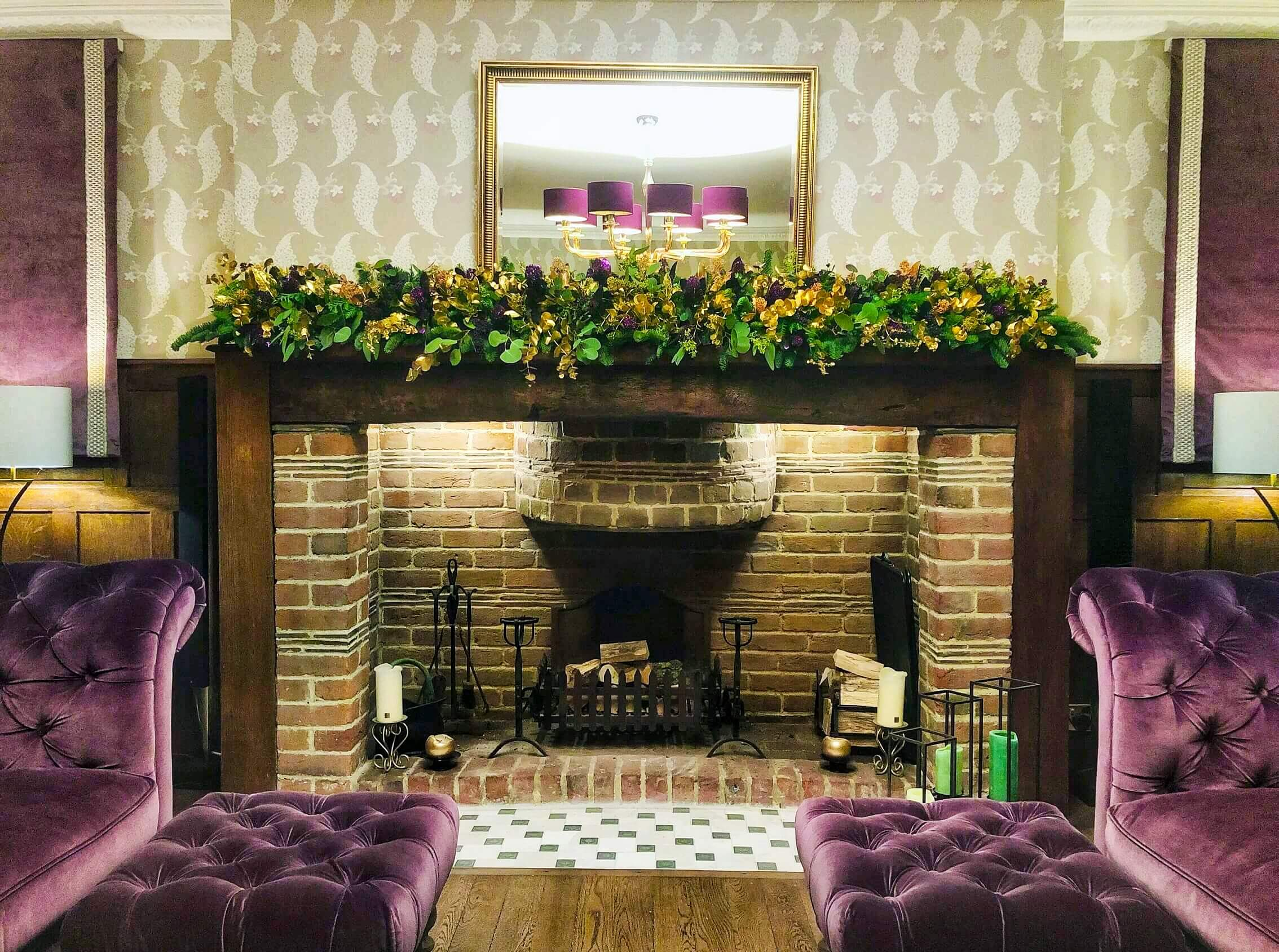 Blooming Boutique Fireplace Christmas Garland - green, gold and purple above brick fireplace