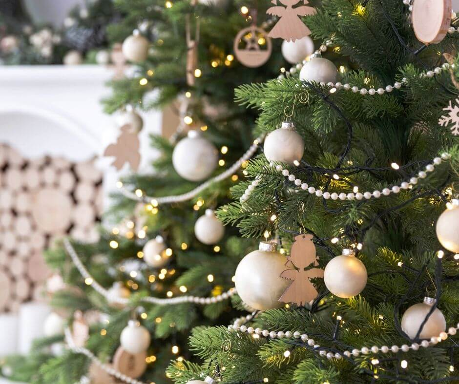 Pale gold and pearl ornaments on Christmas tree