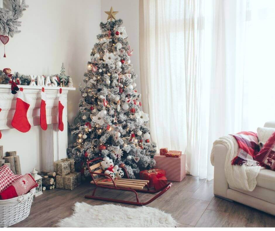 Professionally Decorated Christmas Tree - flocked tree with red ornaments and gold star
