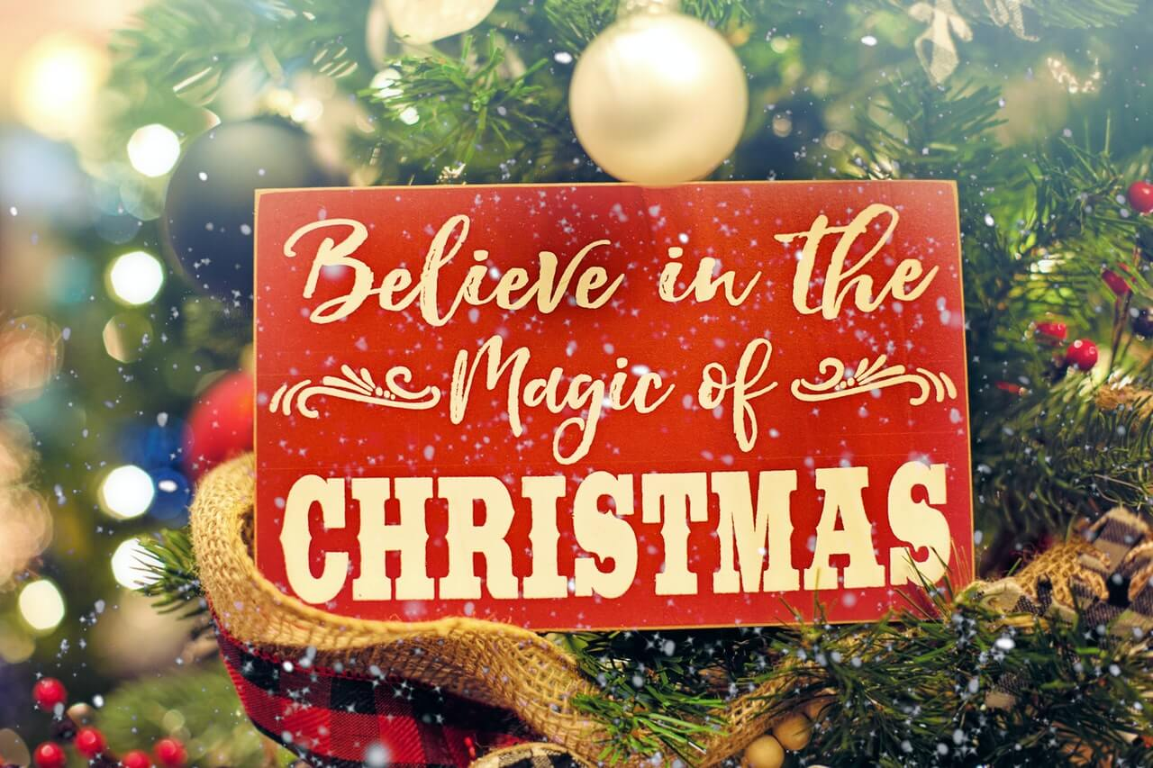 """Retro red Christmas sign saying """"Believe In The Magic of Christmas"""""""