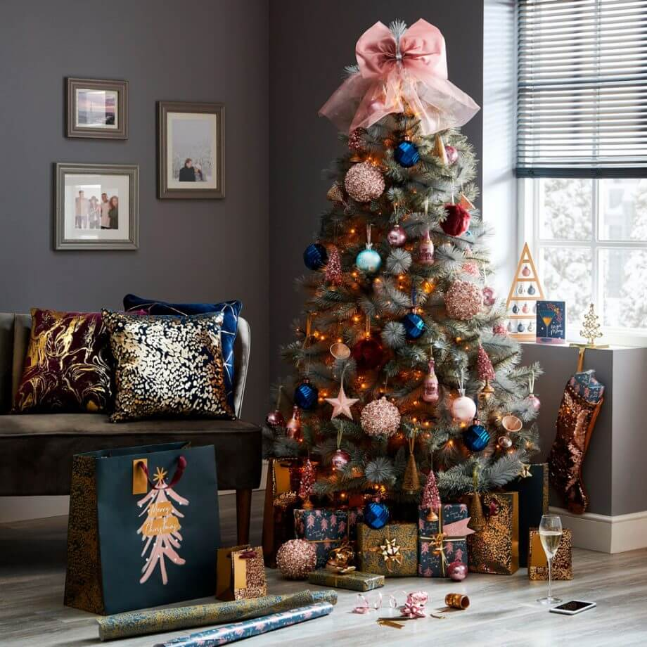 Wilko Christmas Tree in copper and blue with Blush Pink oversized Bow Topper