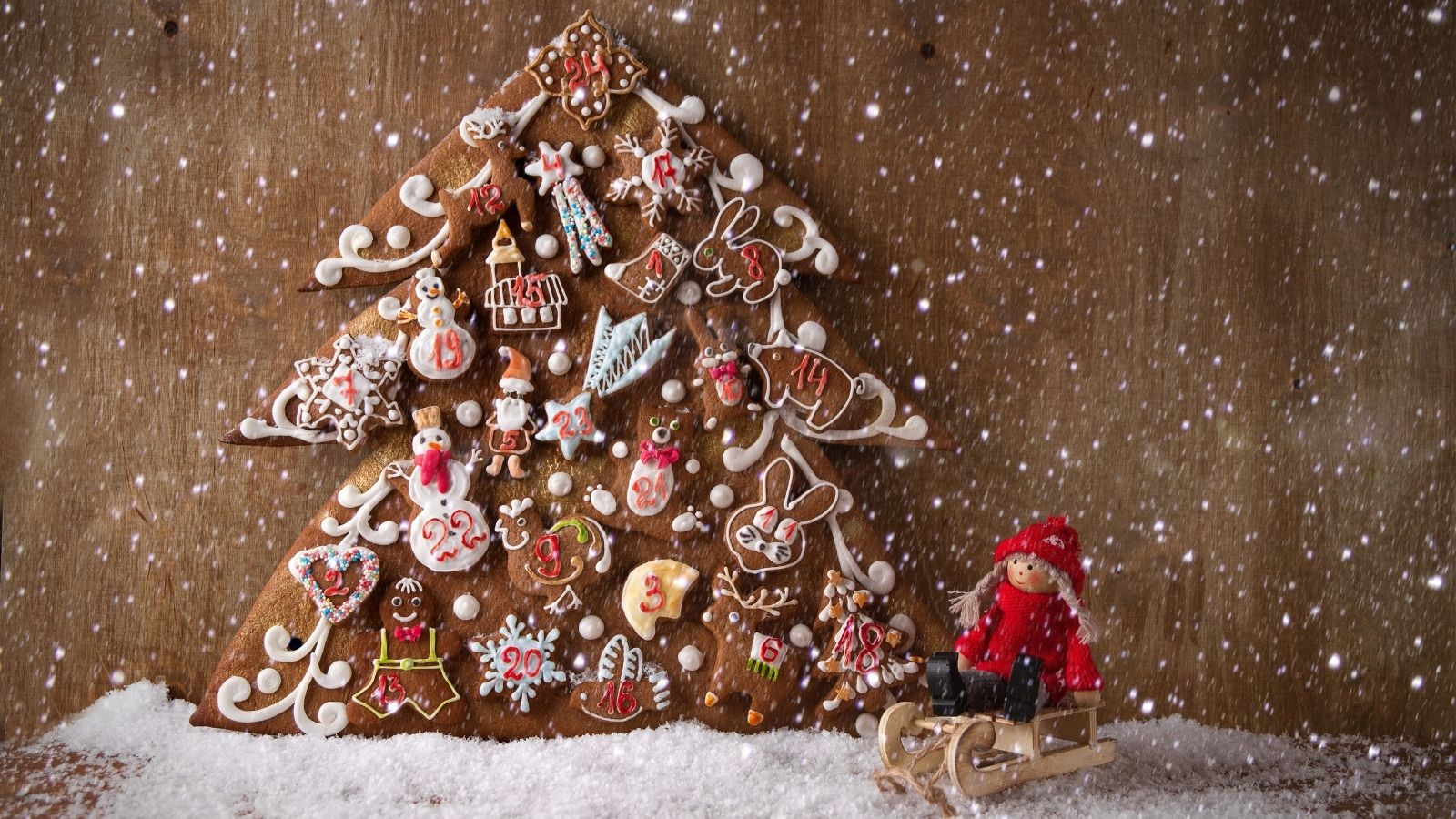 Homemade Advent Calendar Cover Image - Gingerbread Advent Calendar with toy sleigh in front