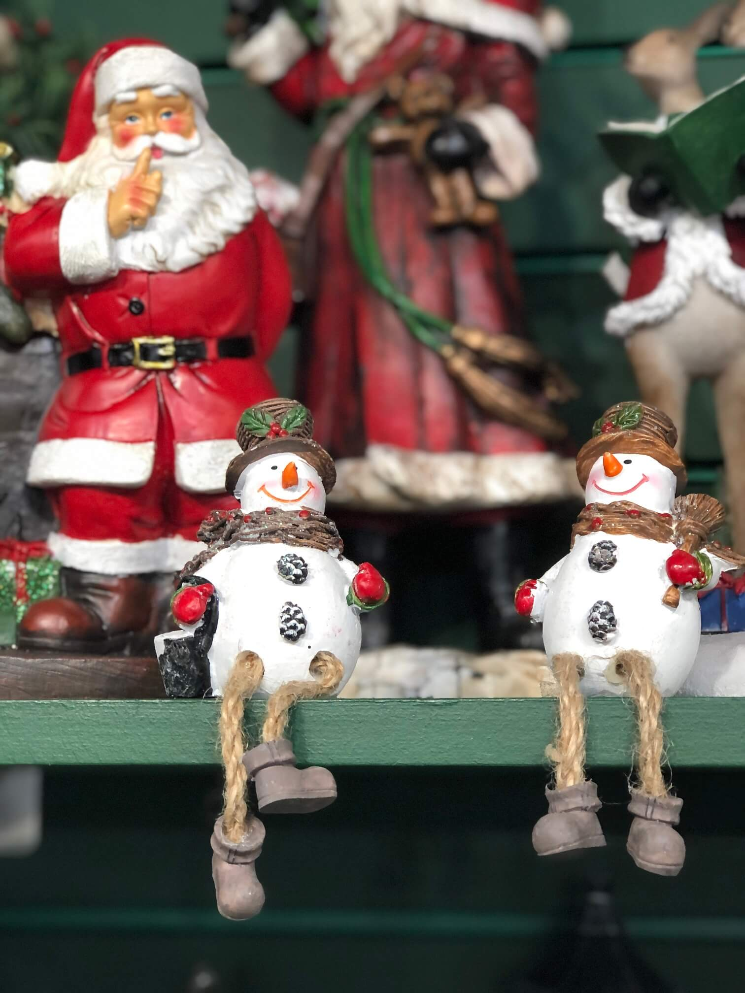 Snowmen Chatting with Santa Watching Behind Ornaments in The Nutcracker shop