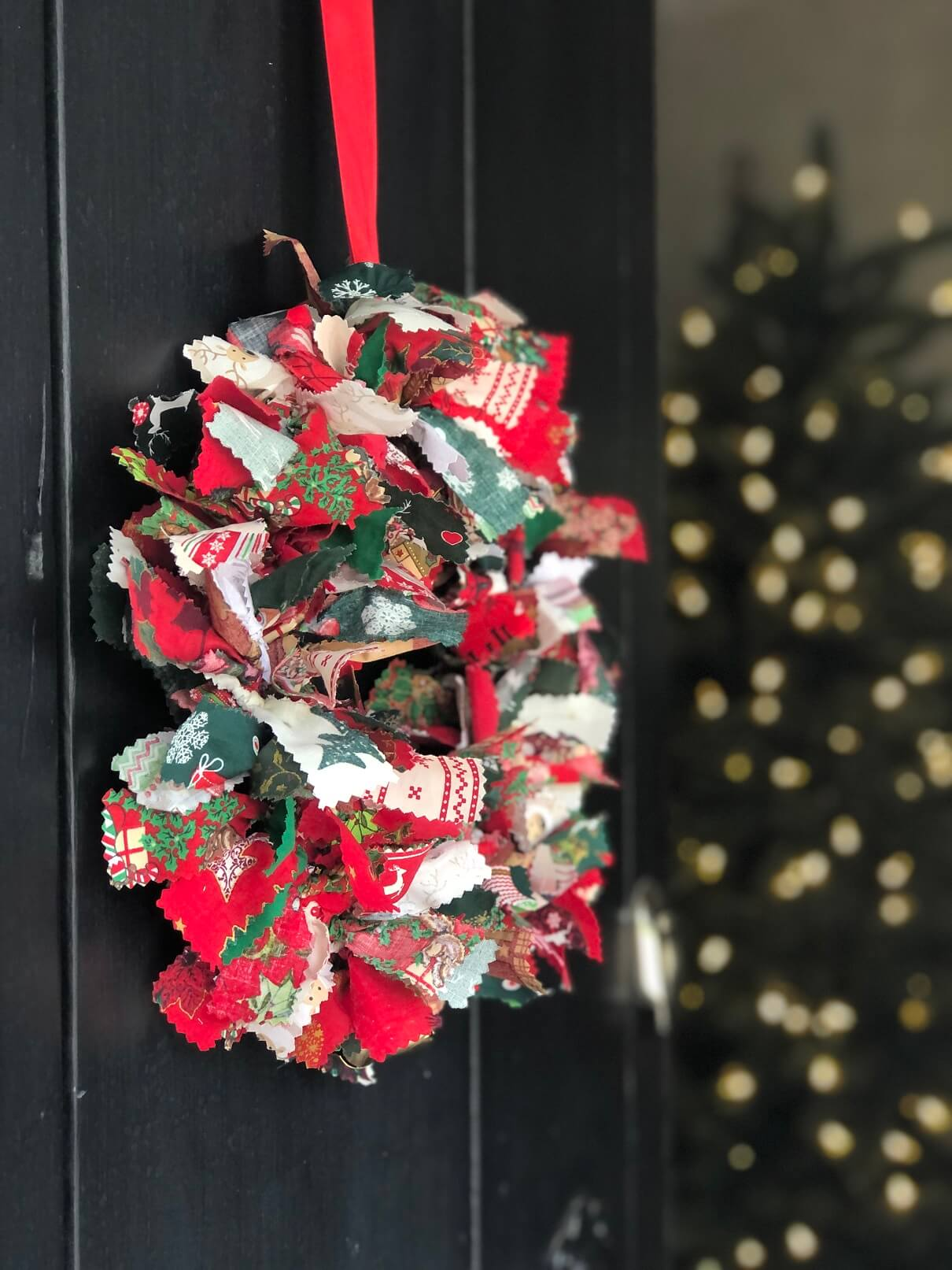 Wreath with Christmas Tree In Background
