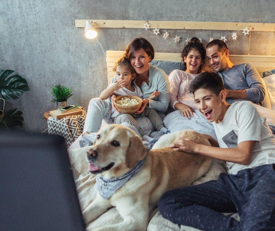 Family watching TV Christmas Movie Advent Calendar free printable